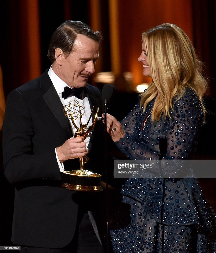 Actor <a gi-track='captionPersonalityLinkClicked' href=/galleries/search?phrase=Bryan+Cranston&family=editorial&specificpeople=217768 ng-click='$event.stopPropagation()'>Bryan Cranston</a> (L) accepts Outstanding Lead Actor in a Drama Series for 'Breaking Bad' from actress <a gi-track='captionPersonalityLinkClicked' href=/galleries/search?phrase=Julia+Roberts&family=editorial&specificpeople=202605 ng-click='$event.stopPropagation()'>Julia Roberts</a> onstage at the 66th Annual Primetime Emmy Awards held at Nokia Theatre L.A. Live on August 25, 2014 in Los Angeles, California.