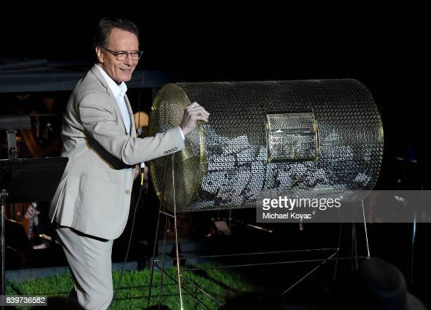 Actor Bryan Cranston presents onstage at the Festival of Arts Celebrity Benefit Event on August 26 2017 in Laguna Beach California