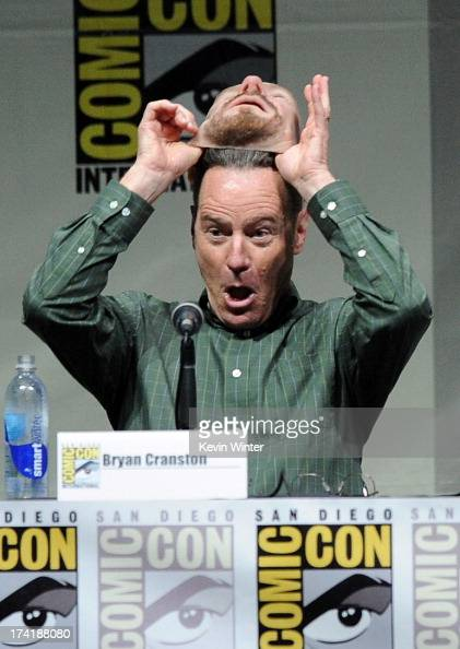 Actor Bryan Cranston pulls off his Walter White mask onstage at the 'Breaking Bad' panel during ComicCon International 2013 at San Diego Convention...