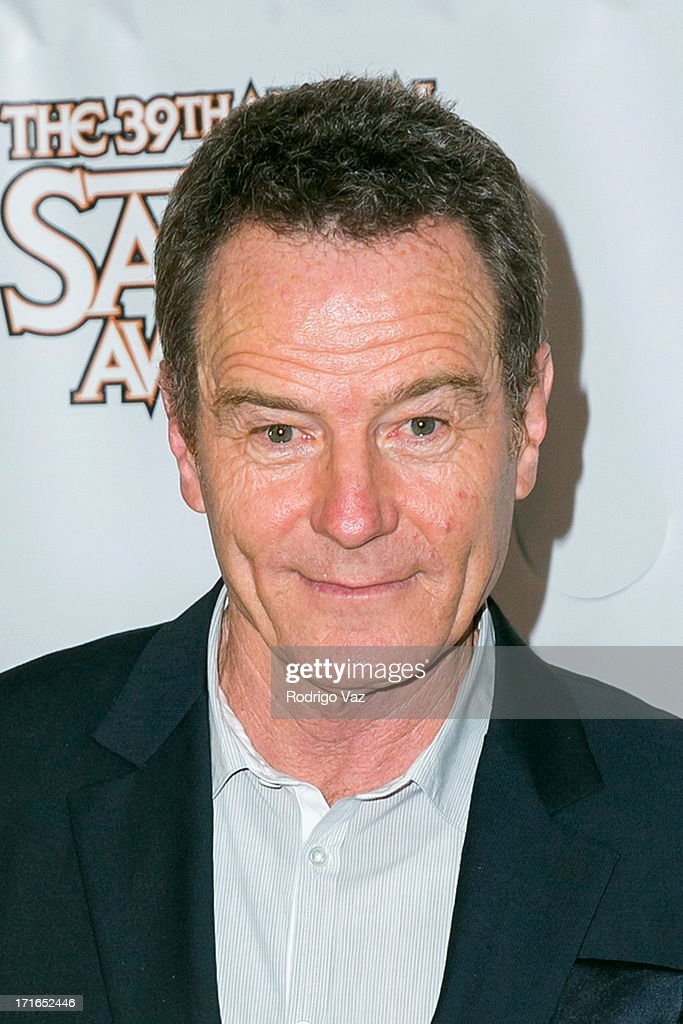 Actor <a gi-track='captionPersonalityLinkClicked' href=/galleries/search?phrase=Bryan+Cranston&family=editorial&specificpeople=217768 ng-click='$event.stopPropagation()'>Bryan Cranston</a> receives an award at the 39th Annual Saturn Awards at The Castaway on June 26, 2013 in Burbank, California.