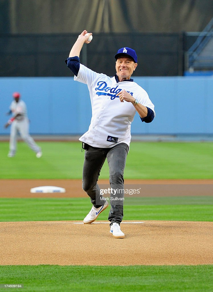 Actor Bryan Cranston throws out the ceremonial first pitch before the MLB game between the Cincinnatti Reds and Los Angeles Dodgers at Dodger Stadium at Dodger Stadium on July 26, 2013 in Los Angeles, California.