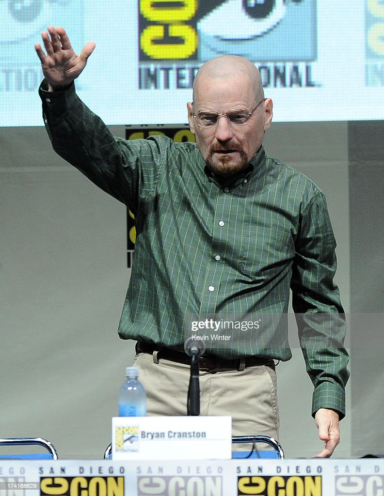 Actor Bryan Cranston wears a Walter White mask onstage at the 'Breaking Bad' panel during ComicCon International 2013 at San Diego Convention Center...