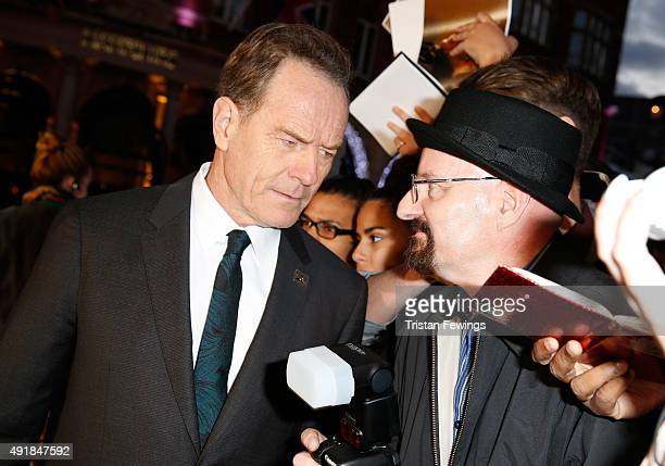 Actor Bryan Cranston with a fan dressed up as his Breaking Bad character Walter White as he attends the 'Trumbo' premiere during the BFI London Film...