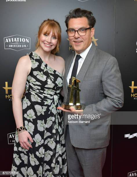 Actor Bryce Dallas Howard poses in the press room with honoree Joe Wright recipient of the Hollywood Director Award for 'Darkest Hour' during the...