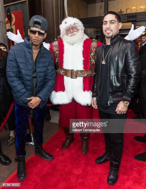 Actor Bryshere Y Gray Santa Claus and professional boxer Danny Garcia attend Macy's Center City Celebrates Its Annual Holiday Window Unveiling And...