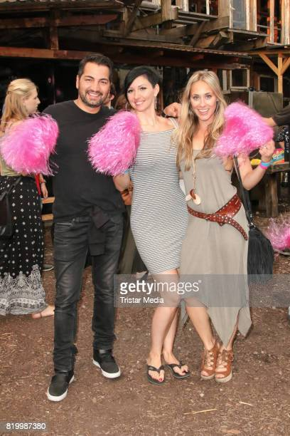 Actor Buelent Sharif Sandra Sperling and actress Sina Tkotsch during the celebration of the FriedrichstadtPalast Christopher Street Day at Mercedes...