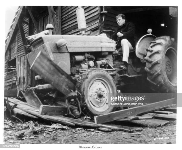 Actor Burt Lancaster drives a tractor on the set of the Universal Pictures movie ' The Midnight Man' in 1974