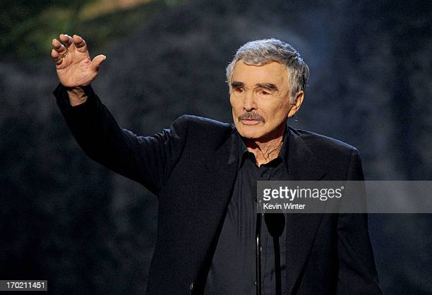 Actor Burt Reynolds accepts award onstage during Spike TV's Guys Choice 2013 at Sony Pictures Studios on June 8 2013 in Culver City California