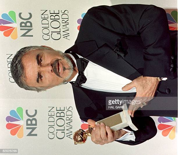 Actor Burt Reynolds holds his Golden Globe Award for Best Supporting Actor in the drama category for his role in 'Boogie Nights' at the 55th Annual...