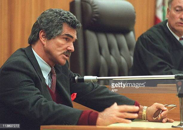 US Actor Burt Reynolds testifies on the stand in Los Angeles 05 December at the start of the divorce trial between Reynolds and US actress Lonnie...