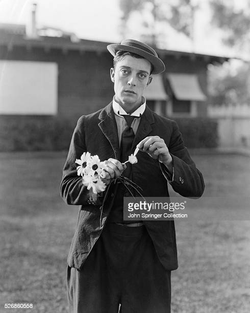 Actor Buster Keaton Picking Petals