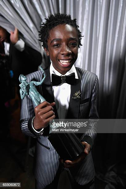 Actor Caleb McLaughlin poses backstage after winning the award for the Outstanding Ensemble in a Drama Series award for 'Stranger Things' during The...