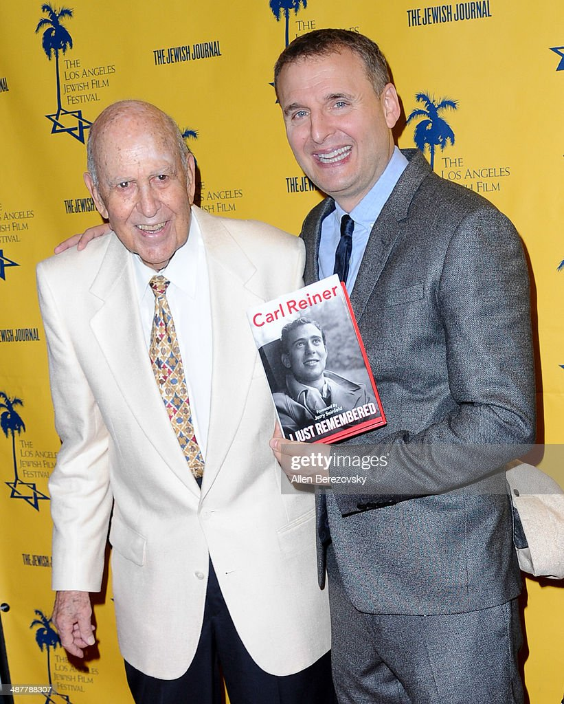 Actor <a gi-track='captionPersonalityLinkClicked' href=/galleries/search?phrase=Carl+Reiner&family=editorial&specificpeople=660635 ng-click='$event.stopPropagation()'>Carl Reiner</a> (L) and writer <a gi-track='captionPersonalityLinkClicked' href=/galleries/search?phrase=Phil+Rosenthal+-+Producer&family=editorial&specificpeople=15068449 ng-click='$event.stopPropagation()'>Phil Rosenthal</a> arrive at the 9th Annual Los Angeles Jewish Film Festival Opening Night Gala honoring <a gi-track='captionPersonalityLinkClicked' href=/galleries/search?phrase=Carl+Reiner&family=editorial&specificpeople=660635 ng-click='$event.stopPropagation()'>Carl Reiner</a> with tributes at Saban Theatre on May 1, 2014 in Beverly Hills, California.