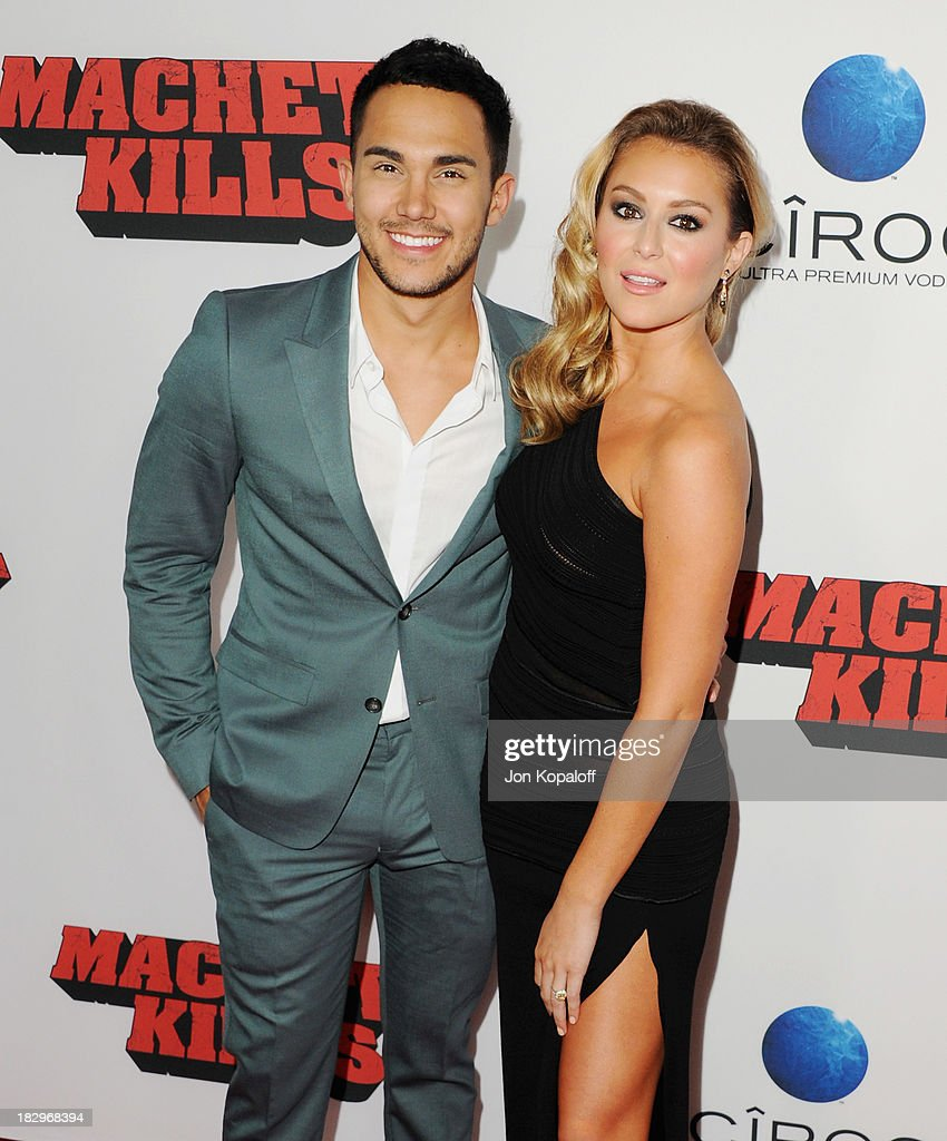 Actor Carlos Pena and actress Alexa Vega arrive at the Los Angeles Premiere 'Machete Kills' at Regal Cinemas L.A. Live on October 2, 2013 in Los Angeles, California.