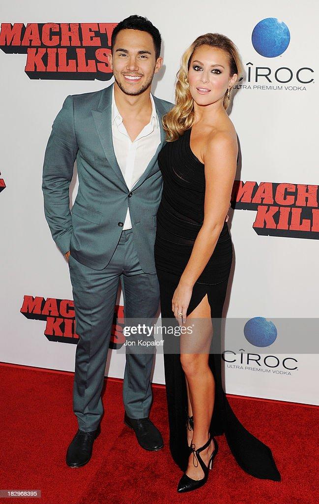 Actor Carlos Pena and actress Alexa Vega arrive at the Los Angeles Premiere 'Machete Kills' at Regal Cinemas L.A. Live on October 2, 2013 in Los Angeles, California.