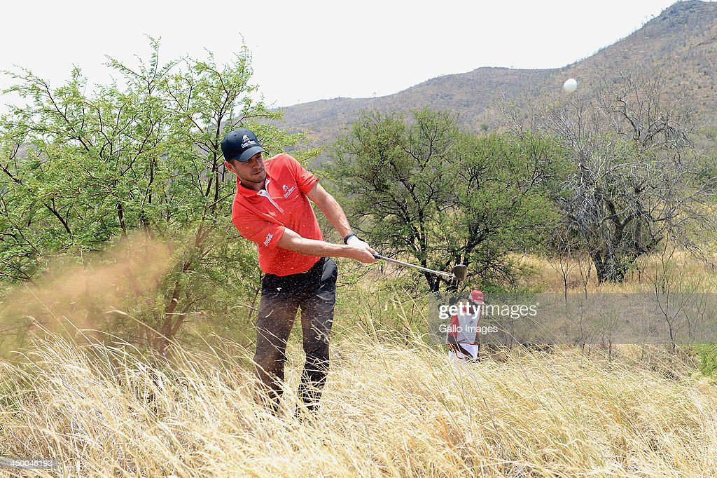 Actor Carmine Giovinazzo plays out of the grass during Round 1 of the Gary Player Invitational presented by Coca-Cola at The Lost City Golf Course on November 16, 2013 in Sun City, South Africa.
