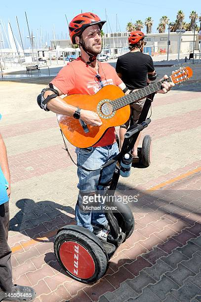 Actor Carmine Giovinazzo serenades bystanders while taking a Segway tour of Tel Aviv on May 31 2012 in Tel Aviv Israel