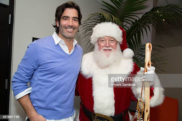 Actor Carter Oosterhouse and Santa Claus attend the HGTV Holiday House KickOff at Santa Monica Place with performance by Il Volo at Santa Monica...