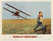 Actor Cary Grant flees from a crop duster plane on a lobby card for Alfred Hitchcock's 1959 thriller 'North by Northwest' an MGM film