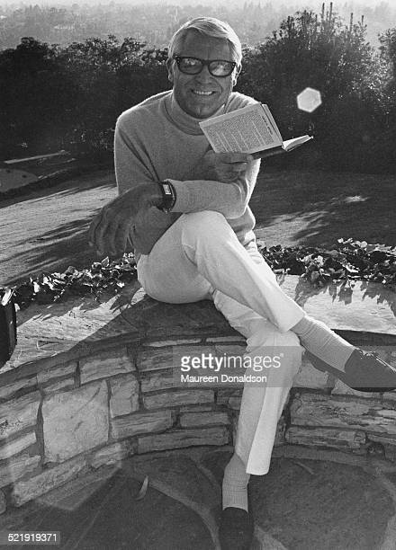 Actor Cary Grant reading a book circa 1980