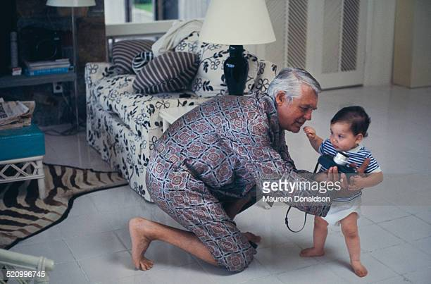 Actor Cary Grant with a baby circa 1978