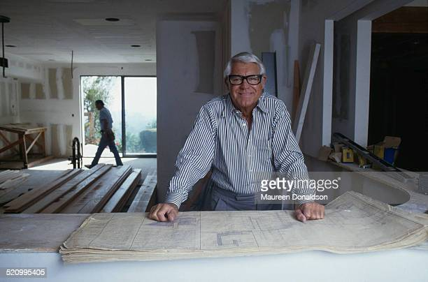 Actor Cary Grant with architectural plans circa 1978