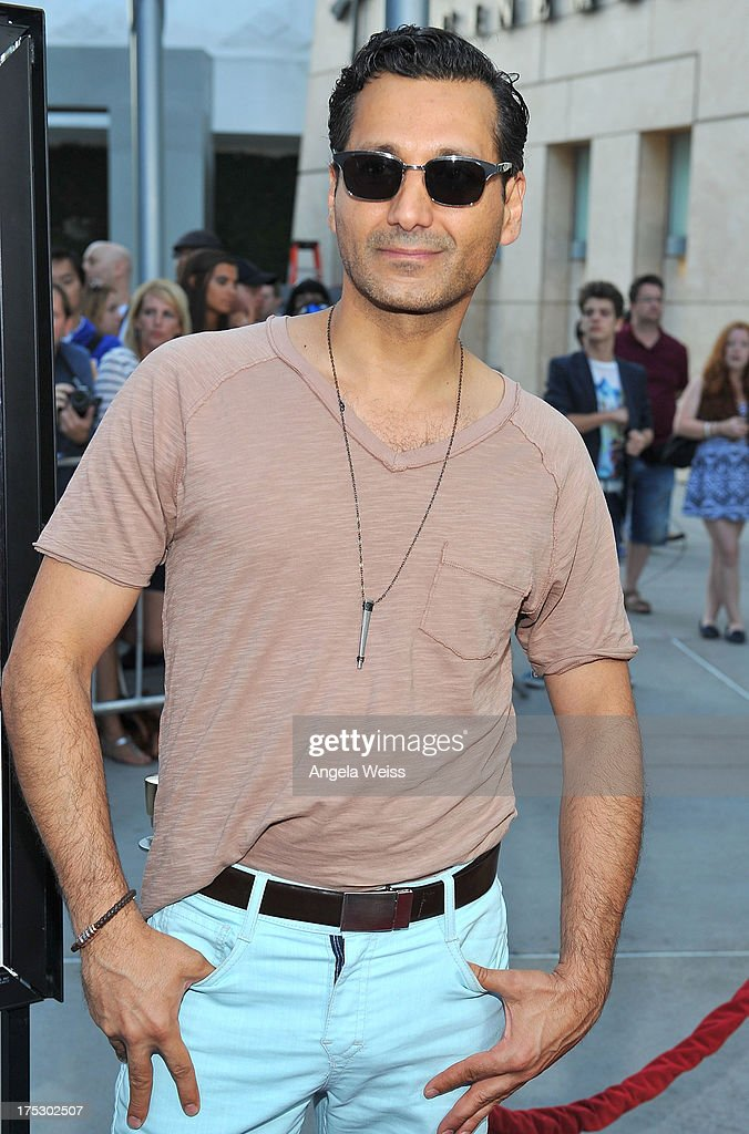 Actor Cas Anvar arrives at the Screening of Magnolia Pictures' 'I Give It A Year' at ArcLight Hollywood on August 1, 2013 in Hollywood, California.