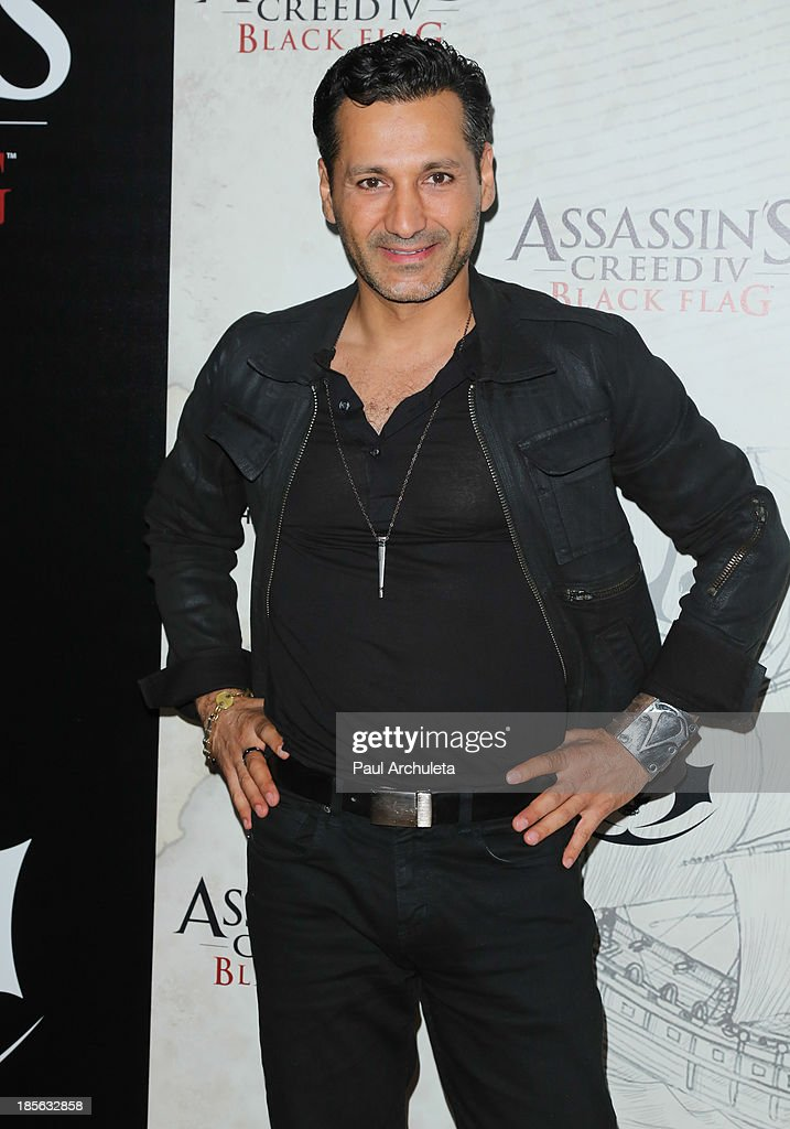 Actor <a gi-track='captionPersonalityLinkClicked' href=/galleries/search?phrase=Cas+Anvar&family=editorial&specificpeople=3139960 ng-click='$event.stopPropagation()'>Cas Anvar</a> attends the launch party for Assassin's Creed IV Black Flag at Greystone Manor Supperclub on October 22, 2013 in West Hollywood, California.