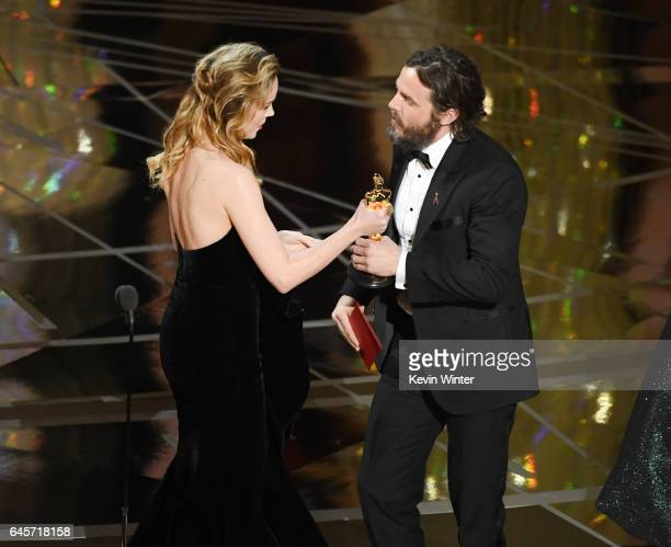 Actor Casey Affleck accepts Best Actor for 'Manchester by the Sea' from actor Brie Larson onstage during the 89th Annual Academy Awards at Hollywood...