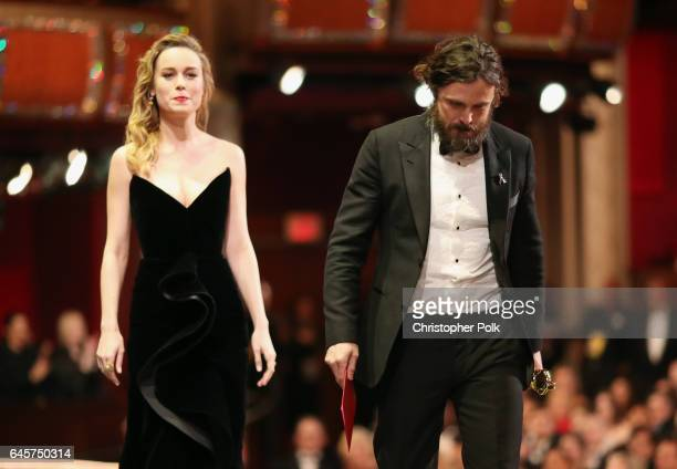 Actor Casey Affleck accepts the Best Actor award for 'Manchester by the Sea' from presenter Brie Larson onstage onstagee during the 89th Annual...