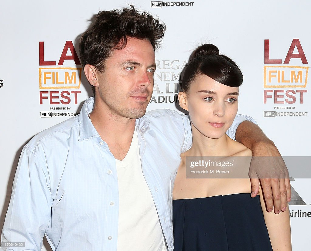 Actor <a gi-track='captionPersonalityLinkClicked' href=/galleries/search?phrase=Casey+Affleck&family=editorial&specificpeople=1539212 ng-click='$event.stopPropagation()'>Casey Affleck</a> (L) and actress <a gi-track='captionPersonalityLinkClicked' href=/galleries/search?phrase=Rooney+Mara&family=editorial&specificpeople=5669181 ng-click='$event.stopPropagation()'>Rooney Mara</a> attend the 2013 Los Angeles Film Festival screening of IFC Films' 'Ain't Them Bodies Saints' at the Regal Cinemas L.A. Live on June 15, 2013 in Los Angeles, California.