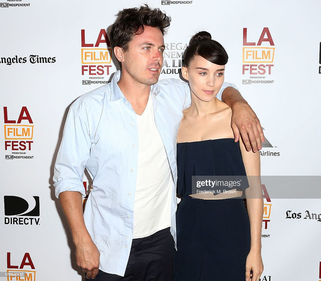 Actor Casey Affleck (L) and actress <a gi-track='captionPersonalityLinkClicked' href=/galleries/search?phrase=Rooney+Mara&family=editorial&specificpeople=5669181 ng-click='$event.stopPropagation()'>Rooney Mara</a> attend the 2013 Los Angeles Film Festival screening of IFC Films' 'Ain't Them Bodies Saints' at the Regal Cinemas L.A. Live on June 15, 2013 in Los Angeles, California.