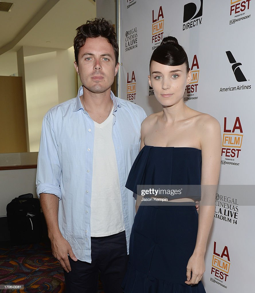 Actor <a gi-track='captionPersonalityLinkClicked' href=/galleries/search?phrase=Casey+Affleck&family=editorial&specificpeople=1539212 ng-click='$event.stopPropagation()'>Casey Affleck</a> and actress <a gi-track='captionPersonalityLinkClicked' href=/galleries/search?phrase=Rooney+Mara&family=editorial&specificpeople=5669181 ng-click='$event.stopPropagation()'>Rooney Mara</a> attend the 2013 Los Angeles Film Festival Screening Of IFC Films' 'Ain't Them Bodies Saints' at Regal Cinemas L.A. Live on June 15, 2013 in Los Angeles, California.