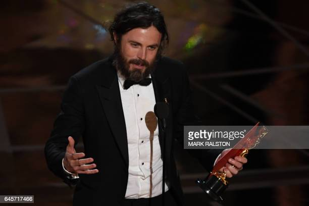 TOPSHOT US actor Casey Affleck delivers a speech on stage after he won the Best Actor award in 'Manchester By The Sea' at the 89th Oscars on February...