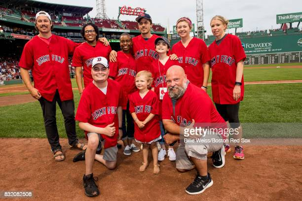 Actor Casey Affleck poses for a photograph with Jimmy Fund patients during a Jimmy Fund RadioTelethon pregame ceremony before a game between the...