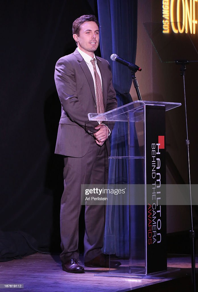 Actor <a gi-track='captionPersonalityLinkClicked' href=/galleries/search?phrase=Casey+Affleck&family=editorial&specificpeople=1539212 ng-click='$event.stopPropagation()'>Casey Affleck</a> speaks onstage during the Hamilton and Los Angeles Confidential Magazine's announcement of the 7th Annual Hamilton Behind The Camera Awards at The Wilshire Ebell Theatre on November 10, 2013 in Los Angeles, California.