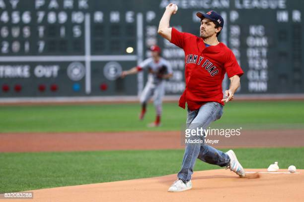 Actor Casey Affleck throws out the first pitch before the game between the Boston Red Sox and the St Louis Cardinals at Fenway Park on August 15 2017...