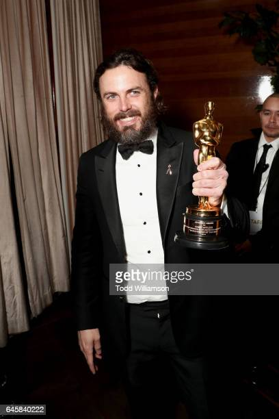 Actor Casey Affleck with his award for best actor in 'Manchester By The Sea' attends the Amazon Studios Oscar Celebration at Delilah on February 26...