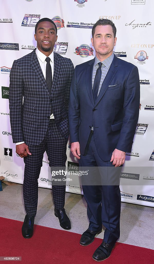 Actor <a gi-track='captionPersonalityLinkClicked' href=/galleries/search?phrase=Chadwick+Boseman&family=editorial&specificpeople=8825549 ng-click='$event.stopPropagation()'>Chadwick Boseman</a> and director <a gi-track='captionPersonalityLinkClicked' href=/galleries/search?phrase=Tate+Taylor&family=editorial&specificpeople=4421502 ng-click='$event.stopPropagation()'>Tate Taylor</a> attends the Get On Up premiere at Regal 20 Cinemas on July 24, 2014 in Augusta, Georgia.