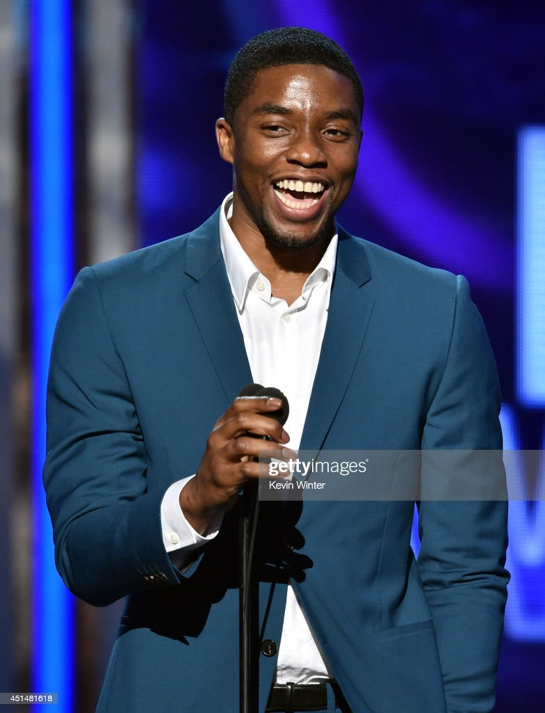 Actor Chadwick Boseman speaks onstage during the BET AWARDS '14 at Nokia Theatre LA LIVE on June 29 2014 in Los Angeles California
