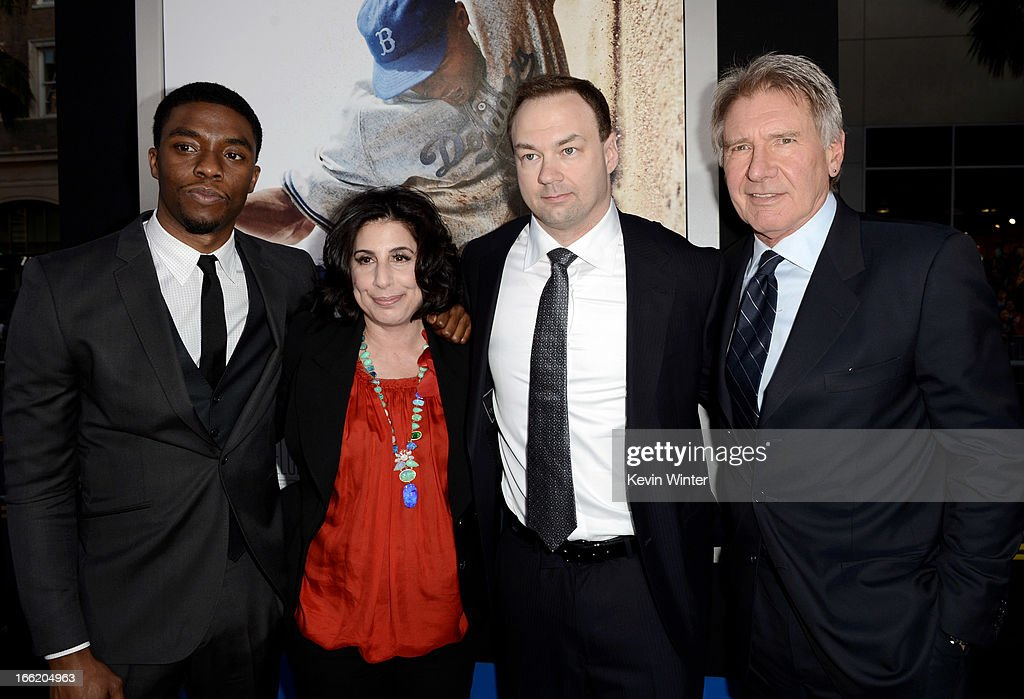 Actor <a gi-track='captionPersonalityLinkClicked' href=/galleries/search?phrase=Chadwick+Boseman&family=editorial&specificpeople=8825549 ng-click='$event.stopPropagation()'>Chadwick Boseman</a>, <a gi-track='captionPersonalityLinkClicked' href=/galleries/search?phrase=Sue+Kroll&family=editorial&specificpeople=2358964 ng-click='$event.stopPropagation()'>Sue Kroll</a>, President, Worldwide Marketing, Warner Bros., producer <a gi-track='captionPersonalityLinkClicked' href=/galleries/search?phrase=Thomas+Tull&family=editorial&specificpeople=549201 ng-click='$event.stopPropagation()'>Thomas Tull</a> and actor <a gi-track='captionPersonalityLinkClicked' href=/galleries/search?phrase=Harrison+Ford+-+Actor+-+Born+1942&family=editorial&specificpeople=11508906 ng-click='$event.stopPropagation()'>Harrison Ford</a> arrive at the premiere of Warner Bros. Pictures' and Legendary Pictures' '42' at the Chinese Theatre on April 9, 2013 in Los Angeles, California.