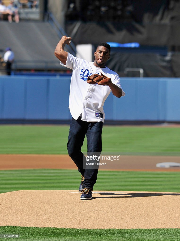 Actor <a gi-track='captionPersonalityLinkClicked' href=/galleries/search?phrase=Chadwick+Boseman&family=editorial&specificpeople=8825549 ng-click='$event.stopPropagation()'>Chadwick Boseman</a> throws out the ceremonial first pitch before the game between the Los Angeles Dodgers and the Colorado Rockies followed by a special screening of '42' at Dodger Stadium on July 13, 2013 in Los Angeles, California.