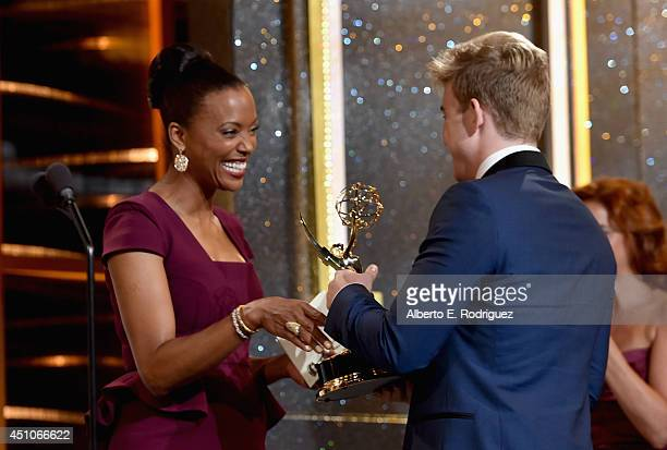 Actor Chandler Massey accepts Outstanding Younger Actor in a Drama Series for 'Days of Our Lives' onstage from actress Aisha Tyler during The 41st...