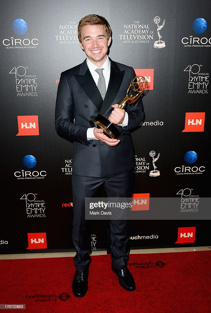 Actor Chandler Massey poses with the Outstanding Younger Actor In A Drama Series award for 'Days of Our Lives' in the press room during The 40th Annual Daytime Emmy Awards at The Beverly Hilton Hotel on June 16, 2013 in Beverly Hills, California.