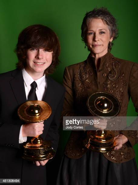 Actor Chandler Riggs and actress Melissa McBride pose for portraits at the 40th Annual Saturn Awards held at The Castaway on June 26 2014 in Burbank...