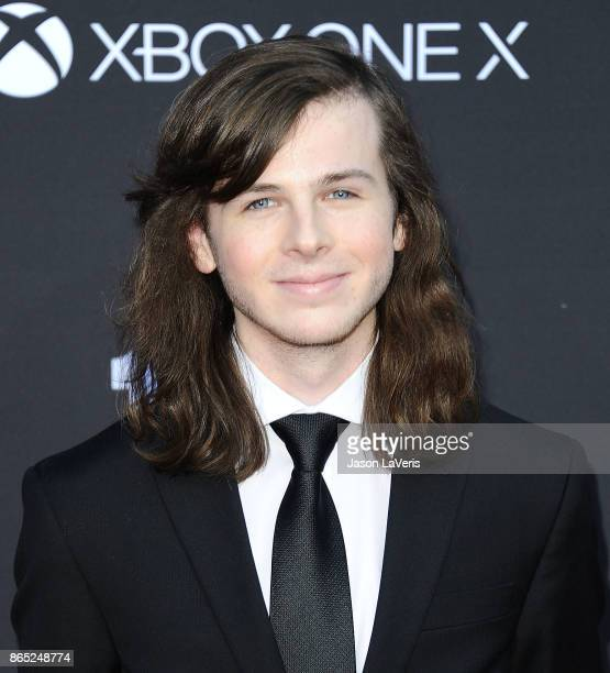 Actor Chandler Riggs attends the 100th episode celebration off 'The Walking Dead' at The Greek Theatre on October 22 2017 in Los Angeles California