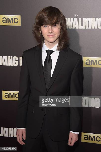 Actor Chandler Riggs attends the season six premiere of 'The Walking Dead' at Madison Square Garden on October 9 2015 in New York City
