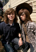 Actor Chandler Riggs poses with a wax figure of his character during ComicCon International 2016 at San Diego Convention Center on July 22 2016 in...