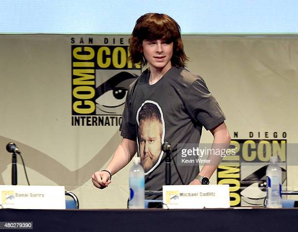 Actor Chandler Riggs walks onstage at AMC's 'The Walking Dead' panel during ComicCon International 2015 at the San Diego Convention Center on July 10...