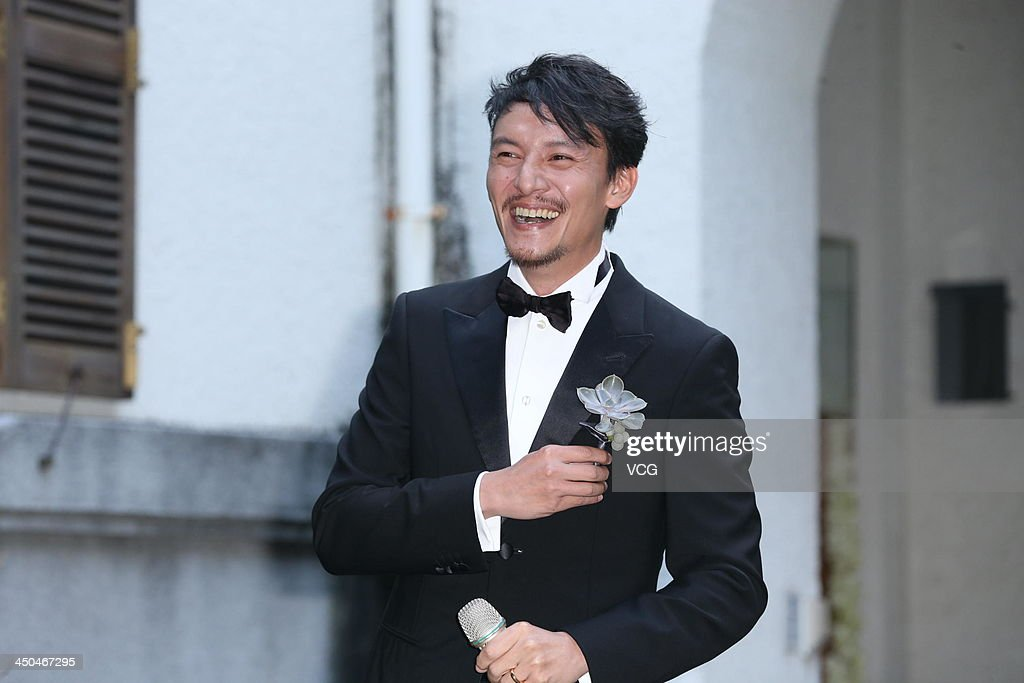Actor Chang Chen poses for photos at his wedding ceremony on November 18, 2013 in Taipei, Taiwan.